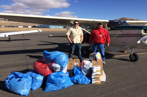 Food blankets shoes socks and Bibles to Darell Garrity yest in Carson City nv pictured with Mitch Pruitt Wof pilot and cfi